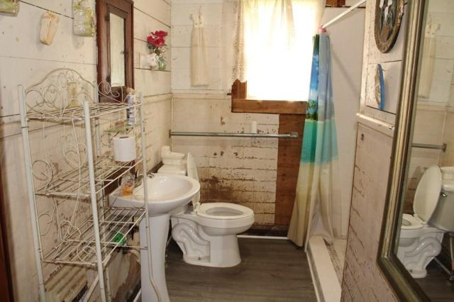 Bathroom featured at 3137 18th St, Port Arthur, TX 77642