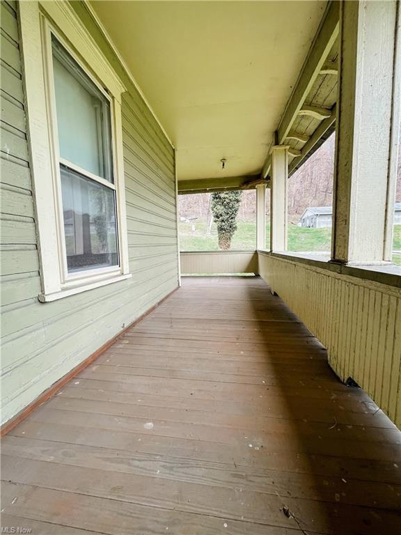 Porch featured at 874 W Main St, Adena, OH 43901