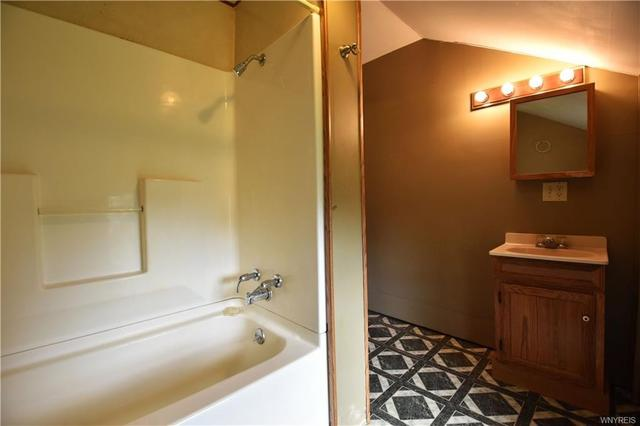 Bathroom featured at 16 Medbury Ave, Cuba, NY 14727