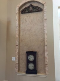 Faux plaster with faux stone edging