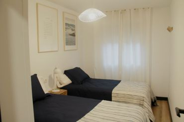 Habitación con camas gemelas de Apartamento Lapamán Bueu