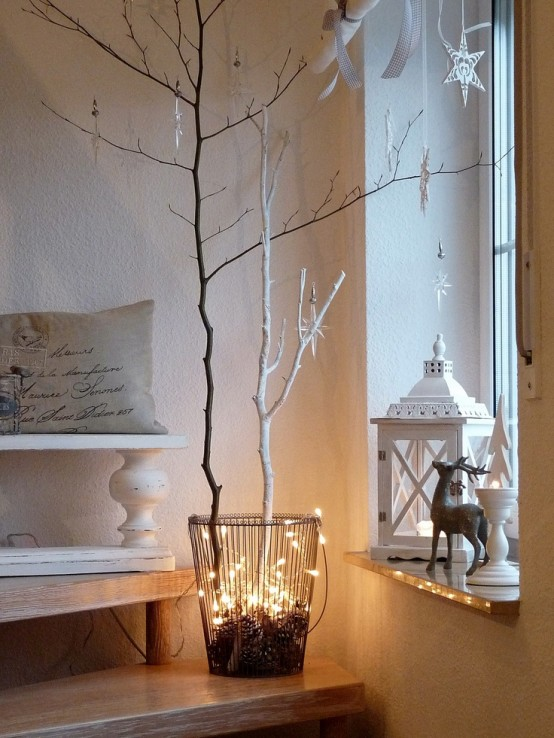 a great minimalist christmas decor choice is to add splashes of seasonal lights in odd places such as a regular plant in your apartment or in a large glass - Minimalist Christmas Decor