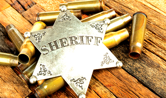 Sheriff badge and bullets shell