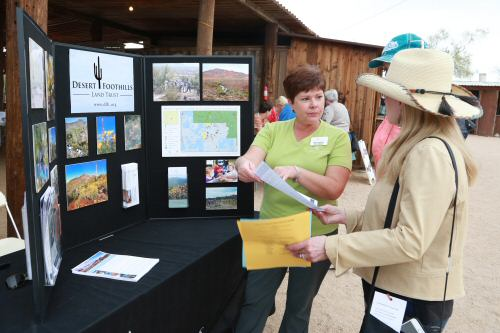 Sonia Perrillo, Desert Foothills Land Trust Executive Director, talks to a guest at the nonprofit's exhibit. (Courtesy of Dennis Liddell.)