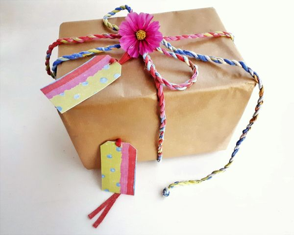 multicoloured gift wrap twine and tags