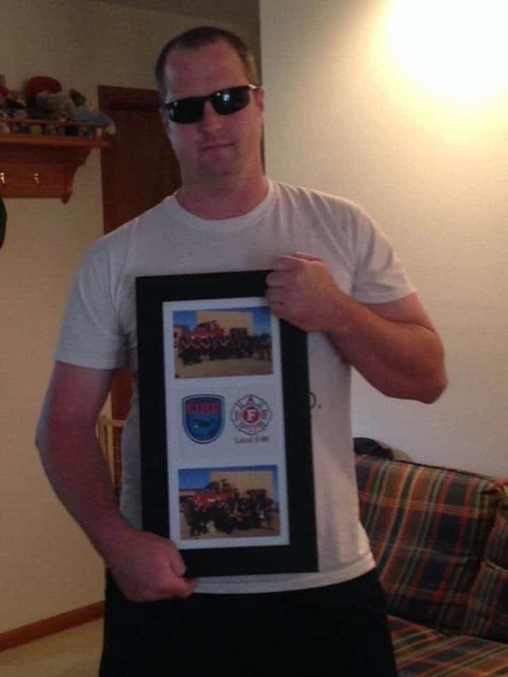 Wright-Patterson Air Force Base firefighter Michael R. Strouse, 38, has worked there for more than decade. He holds a plaque given to him by base firefighters. He was injured during a training incident fall of 2015 when he said piping inside a fire cab ruptured and shot the chemical at high pressure into his eyes. His condition gradually worsened, and he s been off work for more than three months. CONTRIBUTED
