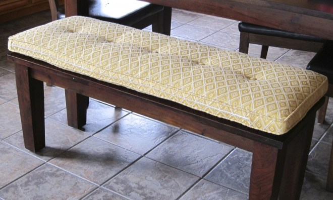 The kitchen bench received a custom cushion that coordinates with the colors found in the family room.