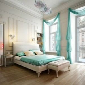 Traditional-Romantic-Bedroom-Design-with-Turquoise-Curtains-and-Wooden-Floors