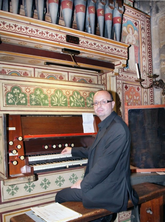 Mark Pescott at the organ in Thorpe Malsor church