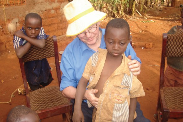 Peter, on a visit to the rural home of a child previously treated for Burkitt's lymphoma