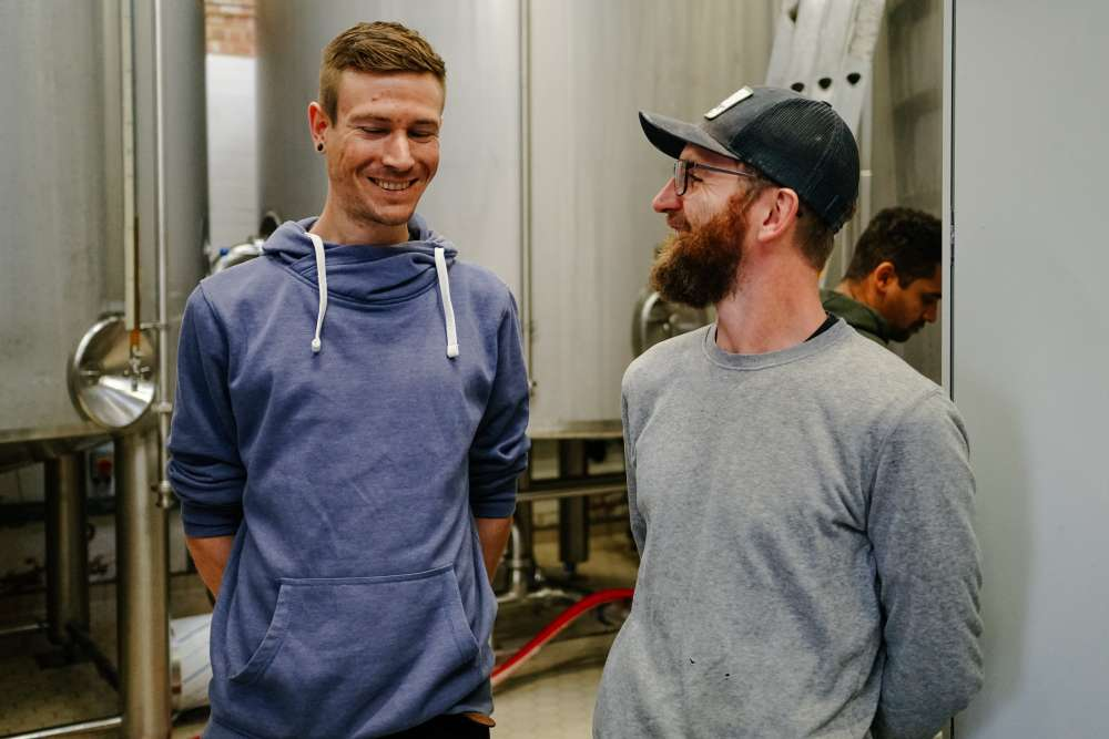Philipp and Jim share a joke while brewing Overkill
