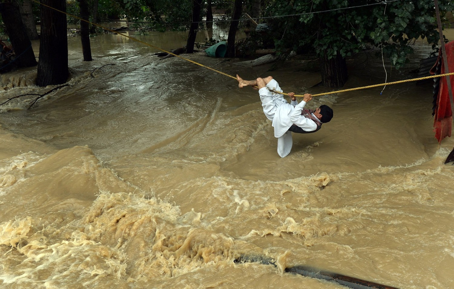 See Dramatic Rescue Scenes from Floods That Killed Over 400 in Pakistan and India | Time