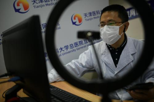 A respiratory and critical care medicine department doctor communicates with patients via Tianjin Medical University General Internet Hospital's platform on March 4, 2020 in Tianjin, China.