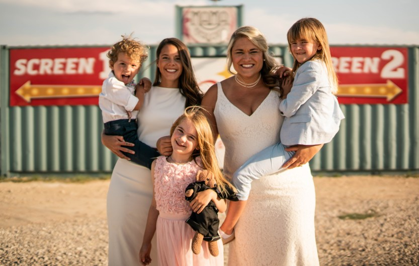 Bri and Lindsey Leaverton, center, with their children at Doc's Drive-In in Buda, Texas.