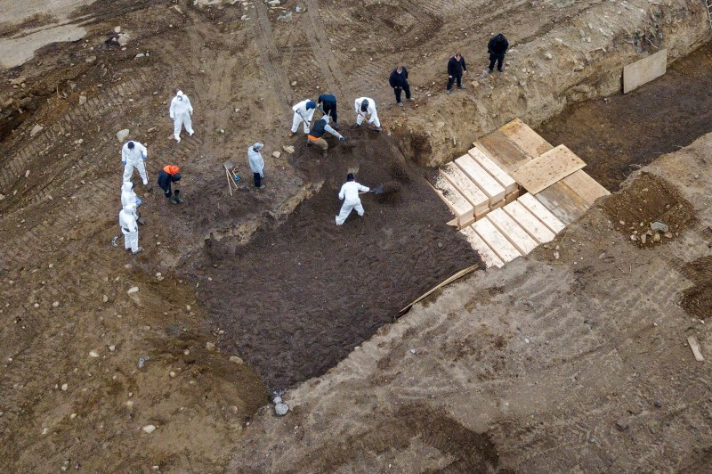 Bodies are buried on New York's Hart Island amid the coronavirus outbreak in New York City, on Apr. 9, 2020.