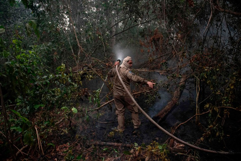 Firefighters work to put out a wildfire in the Porto Jofre region on Sept. 14.