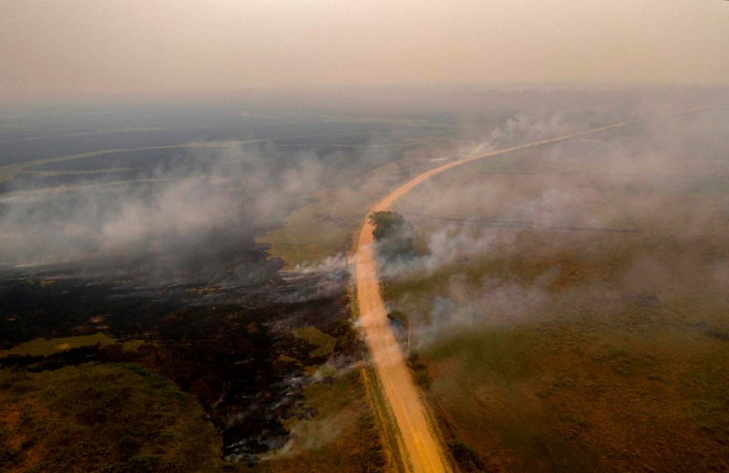 Smoke billows from fires near the Transpantaneira road on Sept. 14.