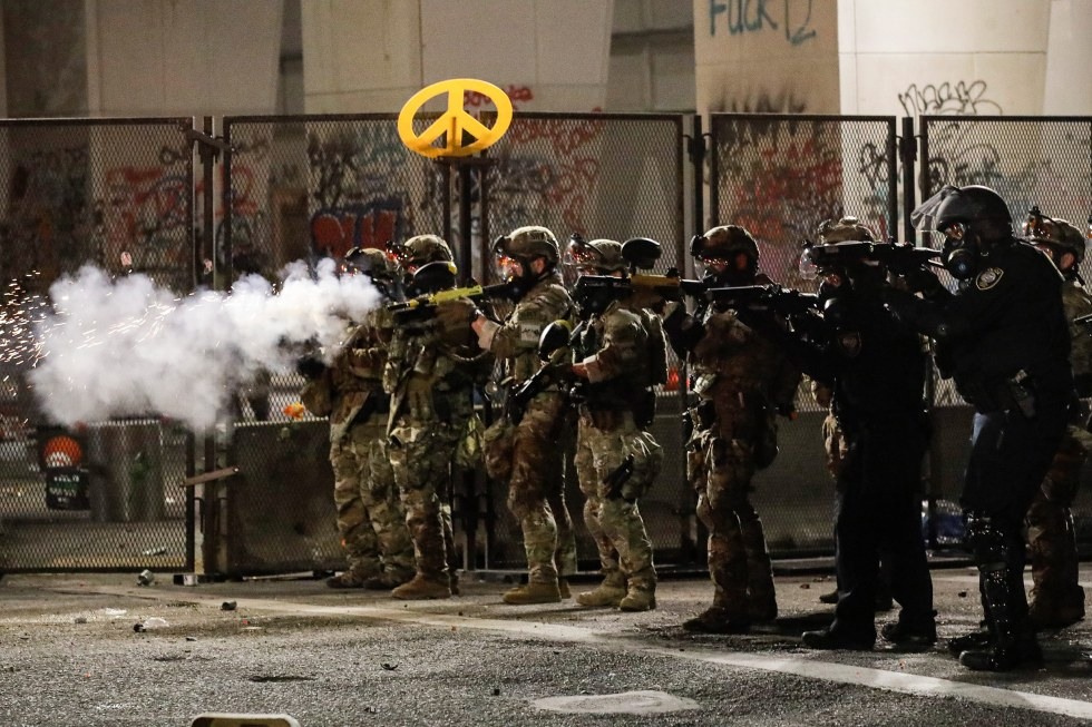 Federal agents use crowd control munitions to disperse Black Lives Matter demonstrators during a protest in Portland, Ore., on July 24.