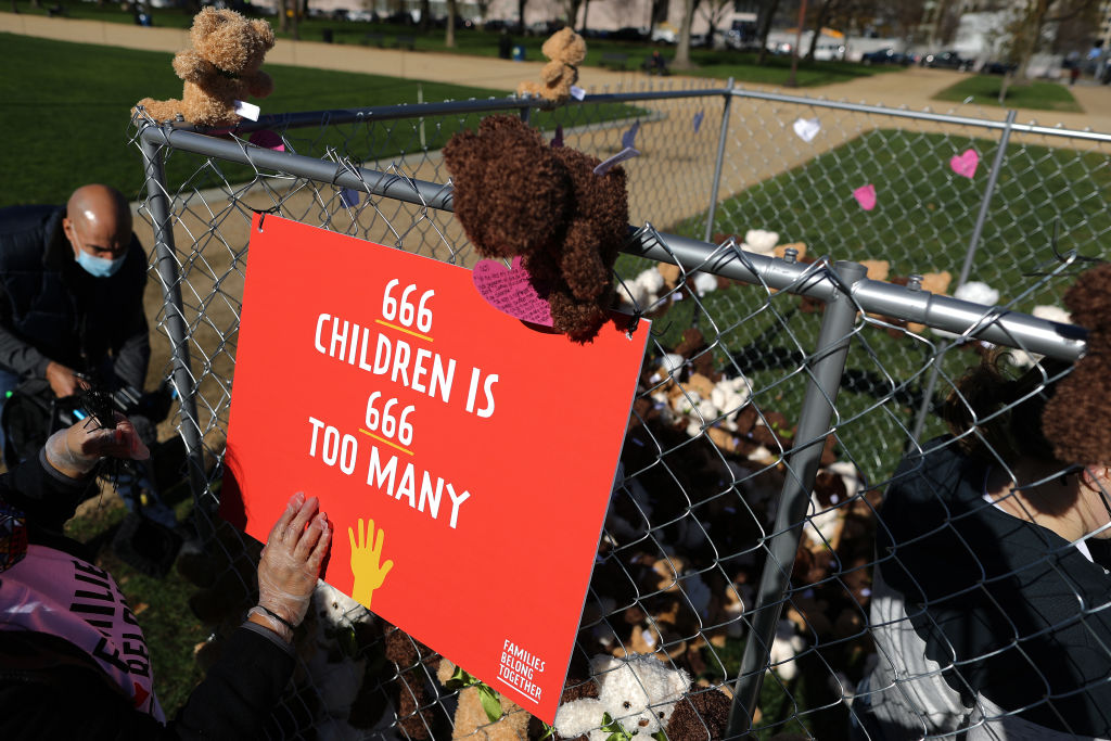 Volunteers from pro-immigration group Families Belong Together build and fill a chainlink cage with about 600 teddy bears 'representing the children still separated as a result of U.S. immigration policies' on the National Mall November 16, 2020 in Washington, DC.