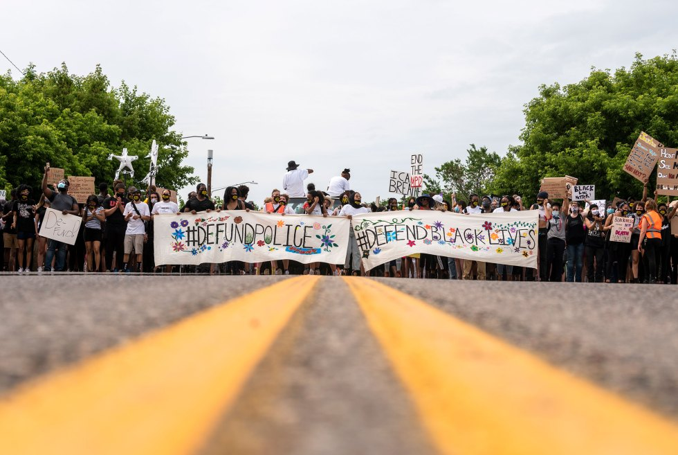 Demonstrators calling to defund the Minneapolis Police Department march in Minneapolis, on June 6, 2020.