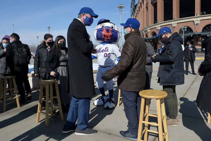 New York City Mayor Bill de Blasio, left, and New York Mets baseball team owner Steve Cohen speak after a press conference to announce the opening of Mets Citi Field stadium as a COVID-19 Vaccine Mega Hub in Queens, N.Y., on Feb. 10, 2021.