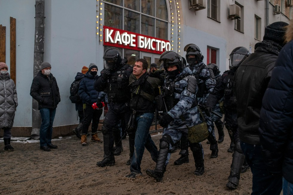 A protester is detained in Moscow on Jan. 31.