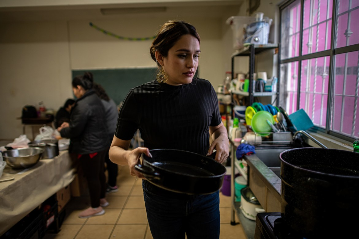 """Shelter coordinator Karina Breceda cooks soup with migrant women in the kitchen. """"When I see my team, they're basically on call 24/7,"""" Breceda says. """"There's a lot of peace, and a lot of healing with the work that they're doing."""