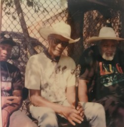 """Butchie, """"Choo Choo"""" Charlie"""", and """"El Dog"""" Ellis Ferrell hang out on Fletcher Street in the summer of 2020."""