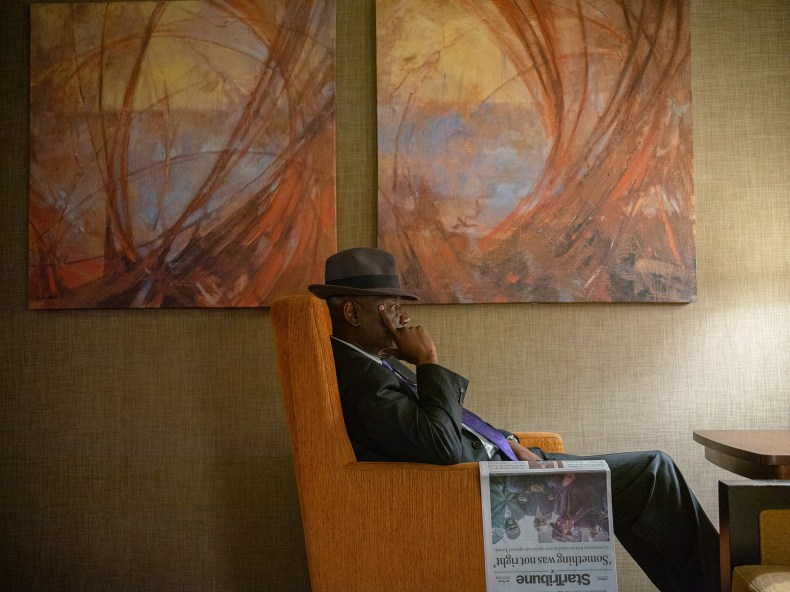 Crump rests after reading the paper in the lobby of the Westin Hotel in Minneapolis on March 30.