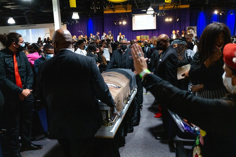 The casket of Daunte Wright was taken from the church after his funeral as his family walked behind it at Shiloh Temple International Ministries in Minneapolis on April 22.