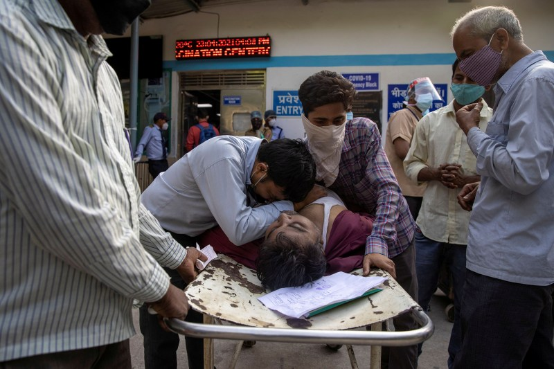Family members mourn after Shayam Narayan, a 45-year-old COVID-19 patient and father of five, is declared dead outside the COVID-19 casualty ward at Guru Teg Bahadur Hospital in Delhi on April 23.