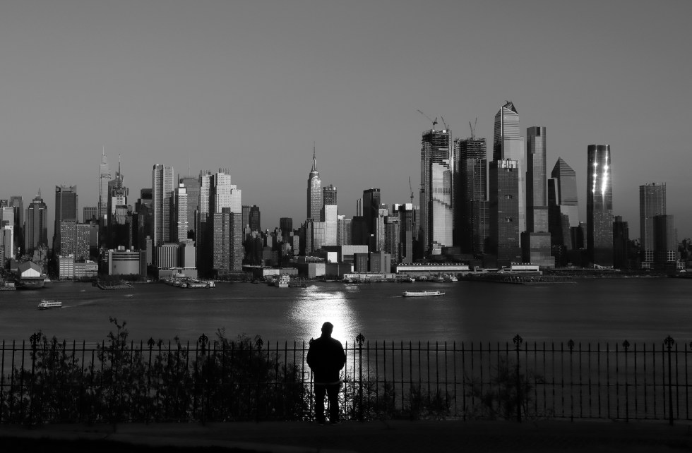 The sun sets on the skyline of midtown Manhattan on April 23 as seen from Weehawken, New Jersey.