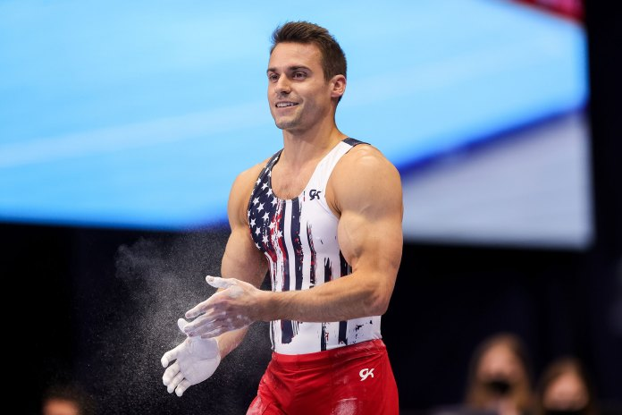 Sam Mikulak prepares to compete on the parallel bars during day 1 of the Men's 2021 U.S. Olympic Trials in St Louis on June 24, 2021.