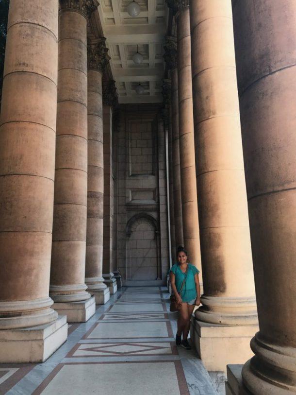 Anna Foster stands next to pillar in Havana Cuba