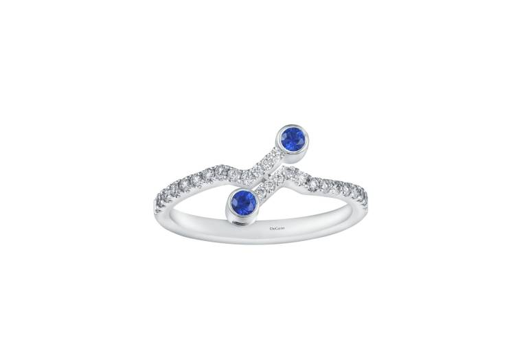 A creative arrangement of round diamonds and mystique blue sapphires is perfect for a touch of celebratory sparkle.