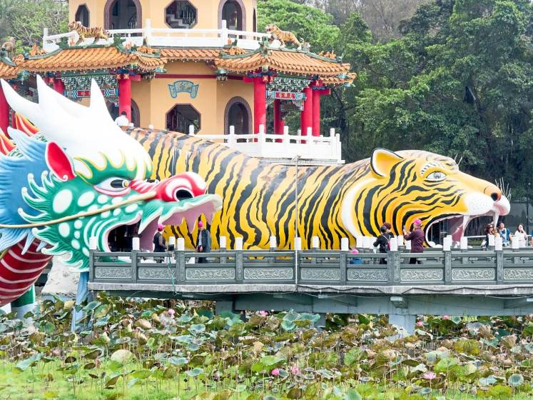 The Dragon and Tiger Pagodas towering over the water, at the temple complex in Kaohsiung.
