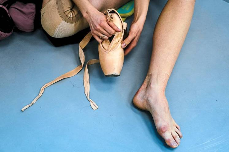 Dancer Alexandra Kirshina rehearses on pointes made at Grishko company especially for her in Moscow. Photo: AFP