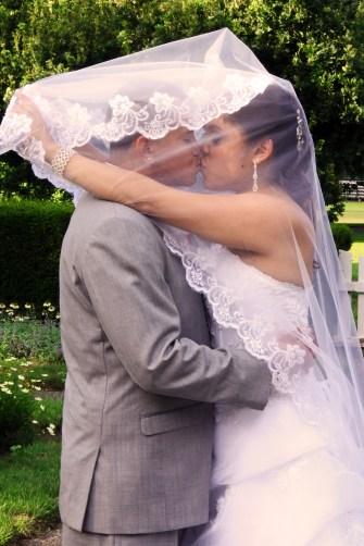 60-bride_kissing_groom-veil_over_face_kiss