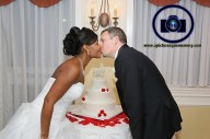 kiss over cake at bridgewater manor wedding photos by NJ wedding photographer apicturesquememoryphotography