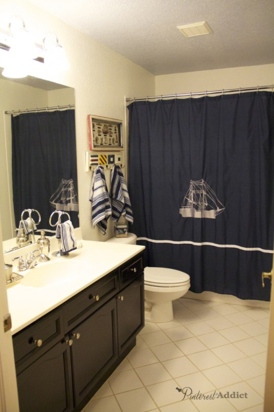 Finished Nautical Inspired Bathroom - navy shower curtain, white and black cabinet