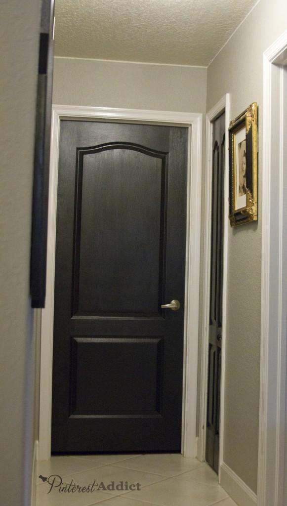 black door hallway