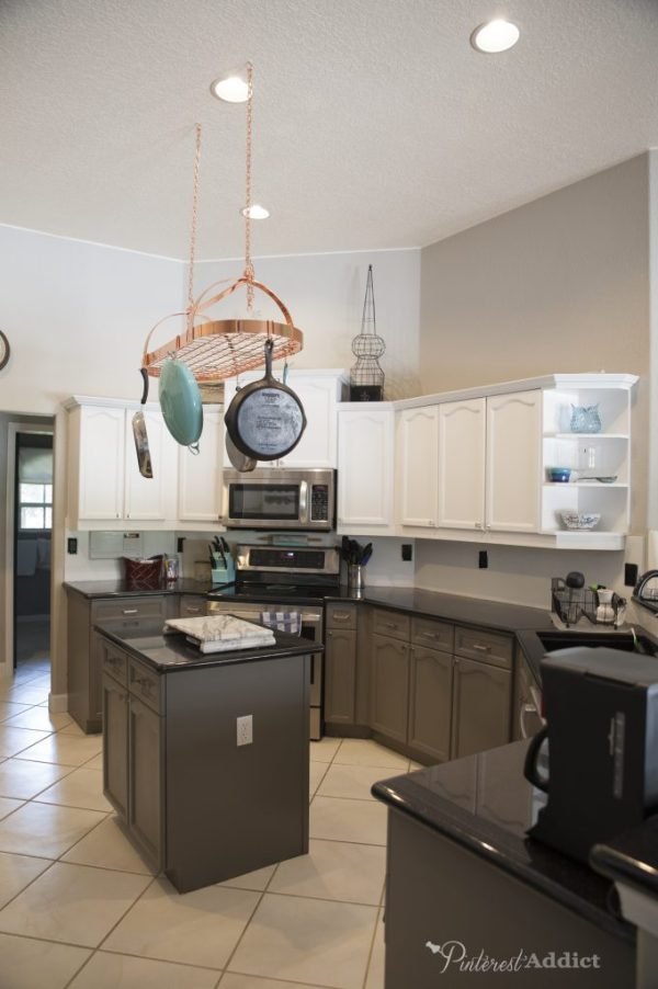 Sherwin Williams Snowbound on the top cabinets, Gauntlet Gray on the lowers.
