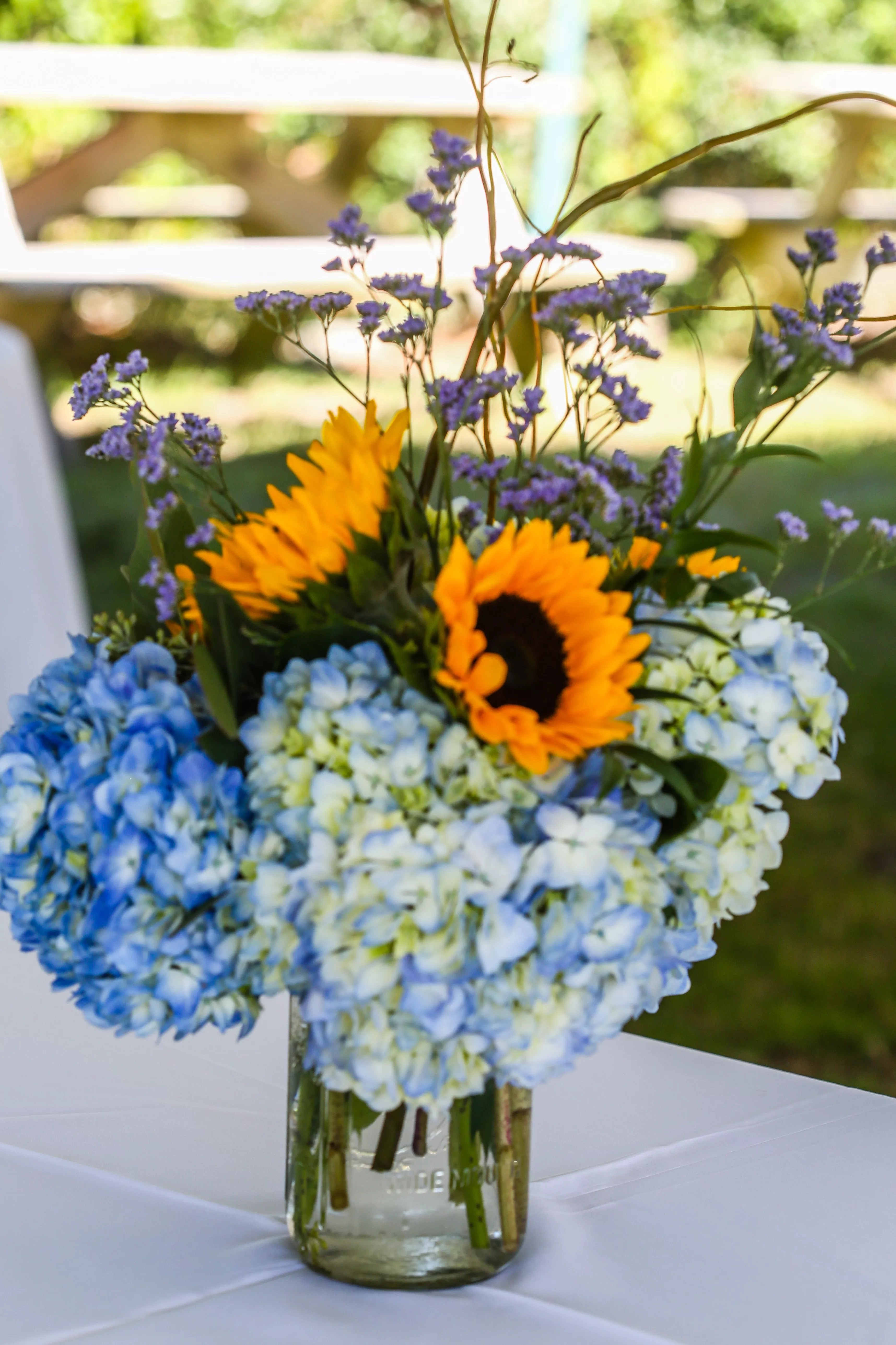 Blue Hydrangea And Sunflower Centerpieces