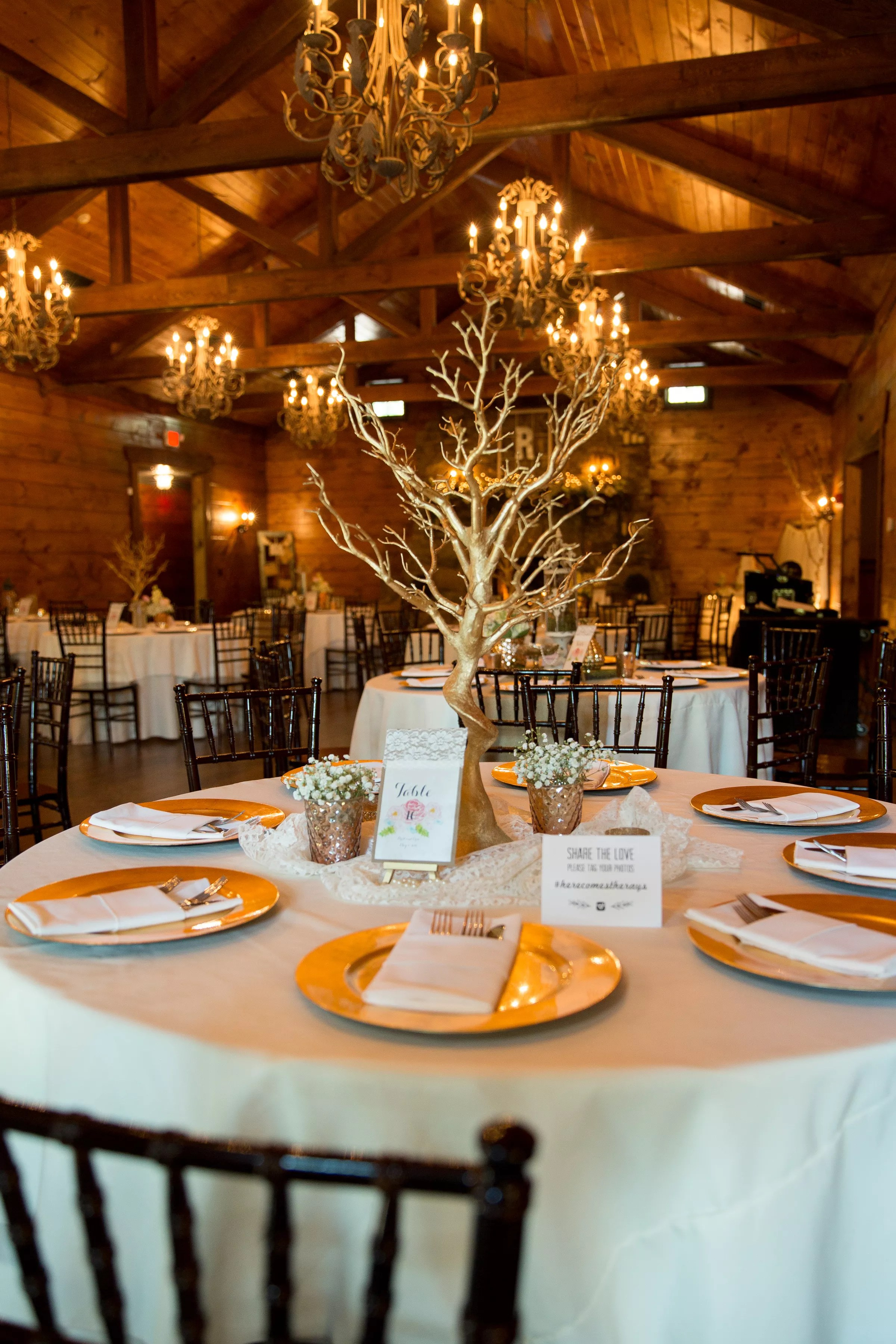 Gold Branch Centerpieces With Gold Chargers