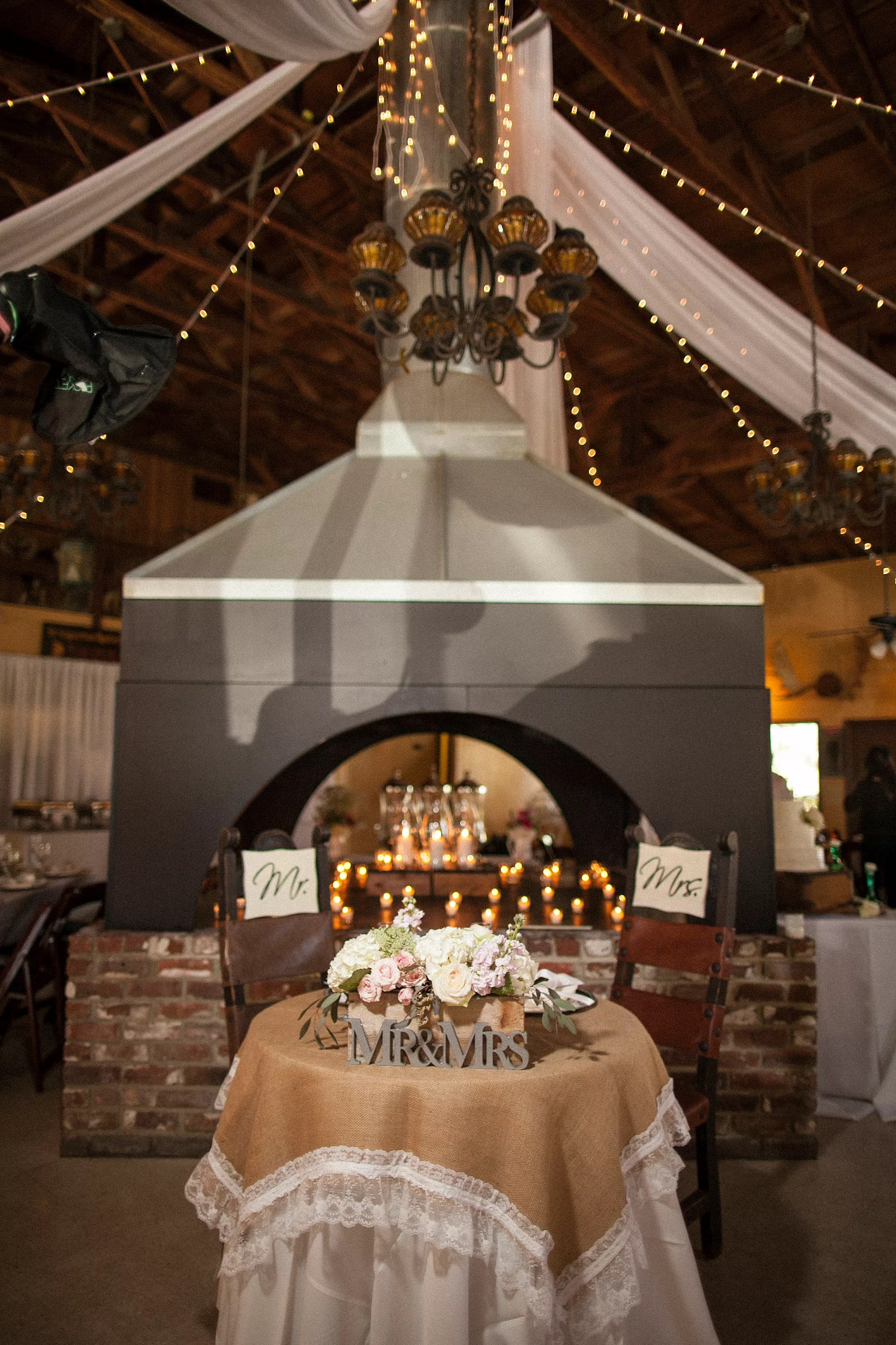 Rustic Sweetheart Table With Fireplace Backdrop