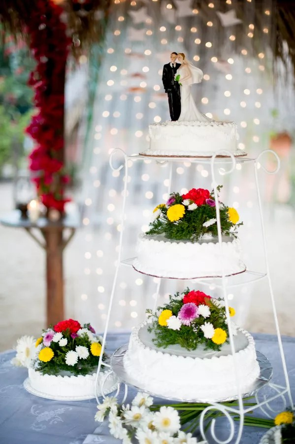 Separated Tier Wedding Cake With Bright Flowers