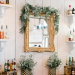 Rustic Bar With Decorative Mirror And Greenery