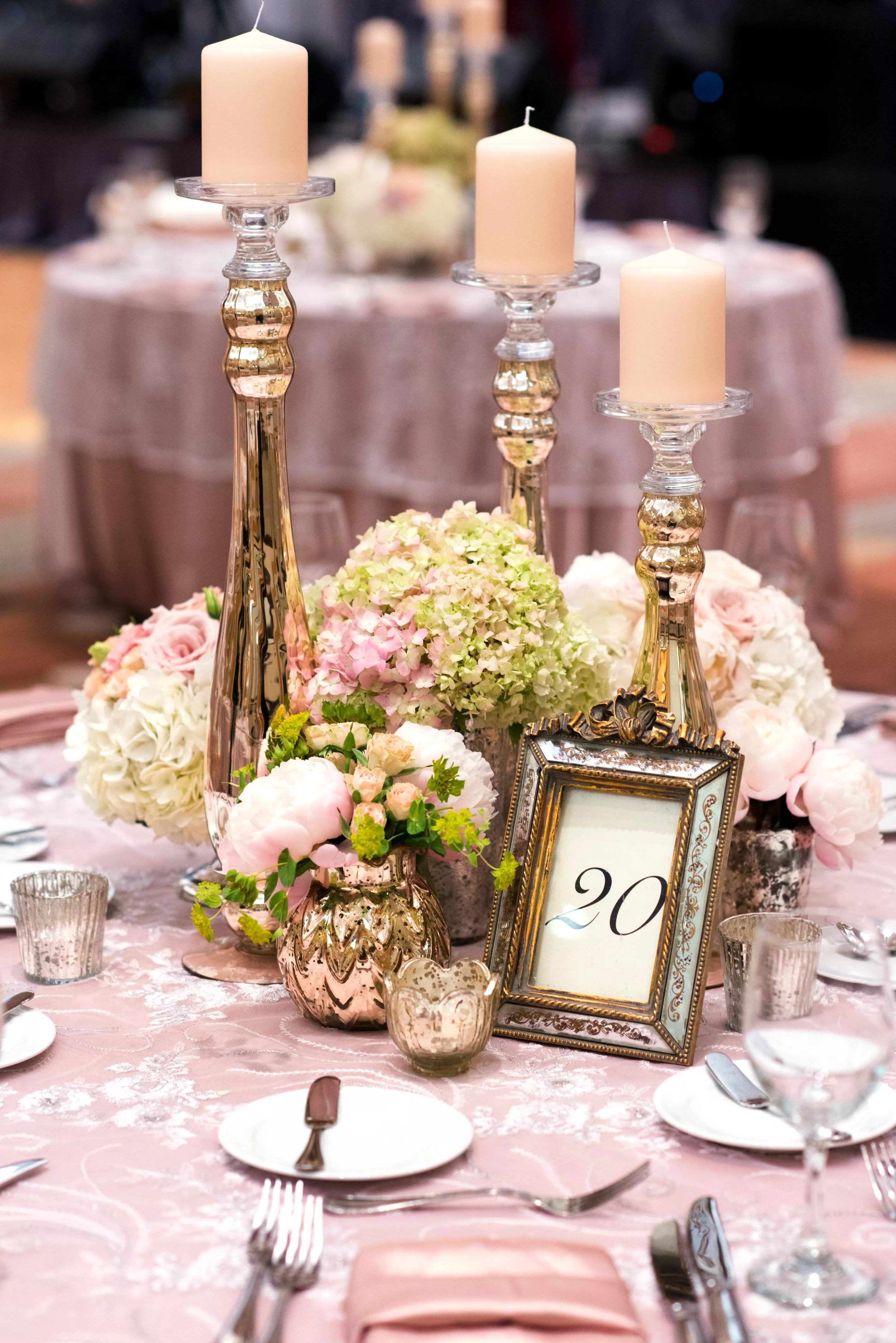 Romantic Centerpieces With Tall Gold Candlesticks