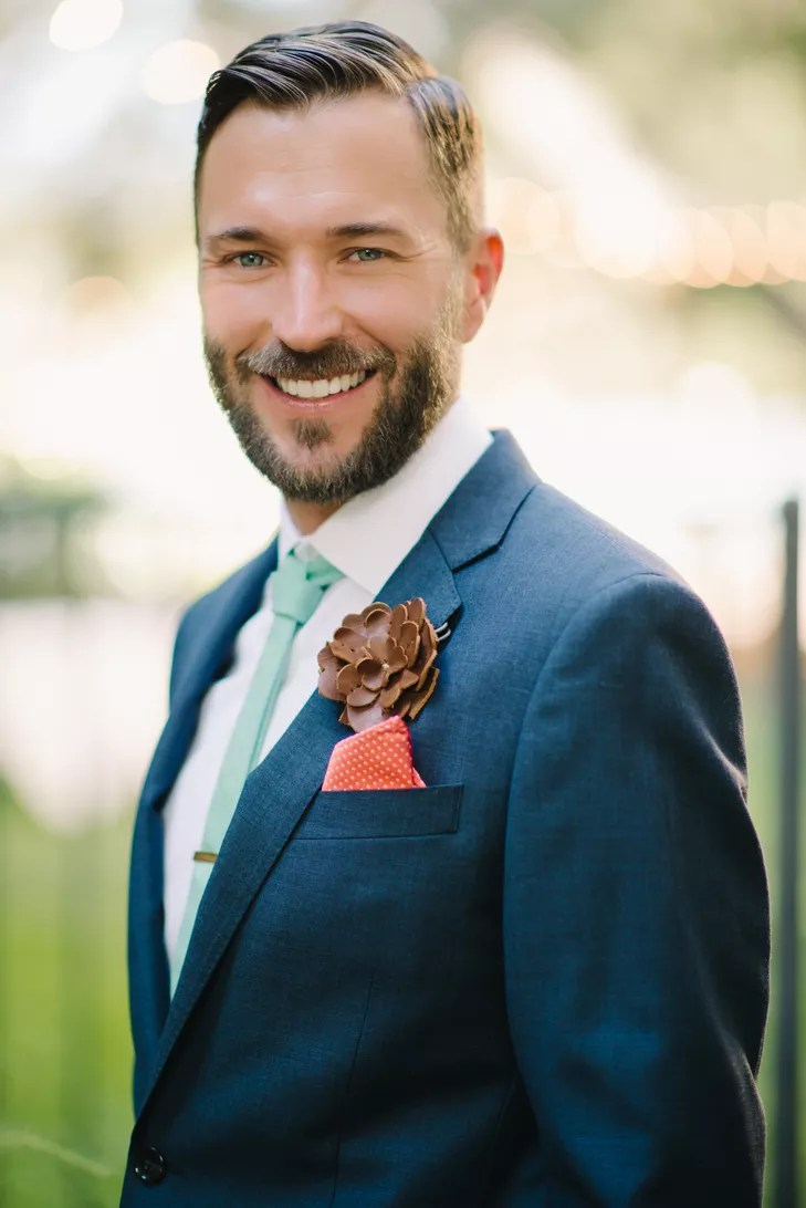 Navy Grooms Suit With Leather Flower Lapel Pin