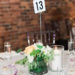 Simple White Floral Centerpieces And Candles